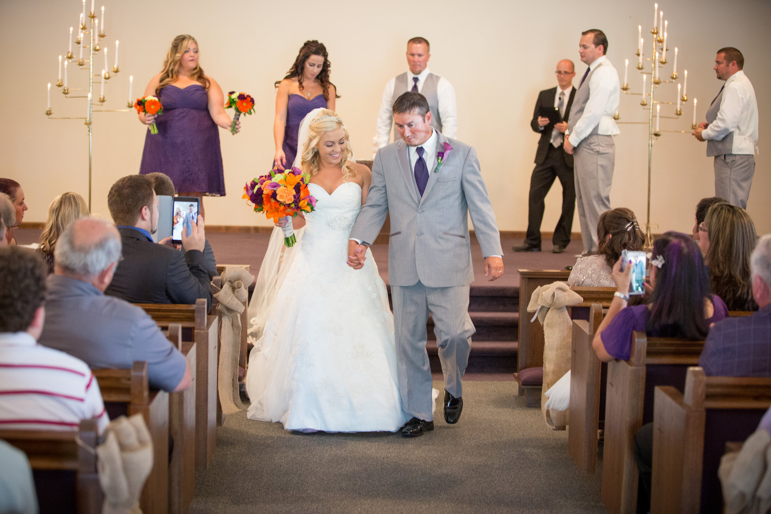 Bride and groom walking down aisle as husband and wife