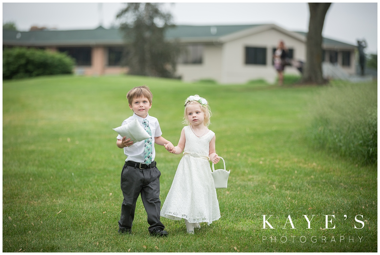 flower girl and ring bearer at a same sex wedding by Kaye's photography