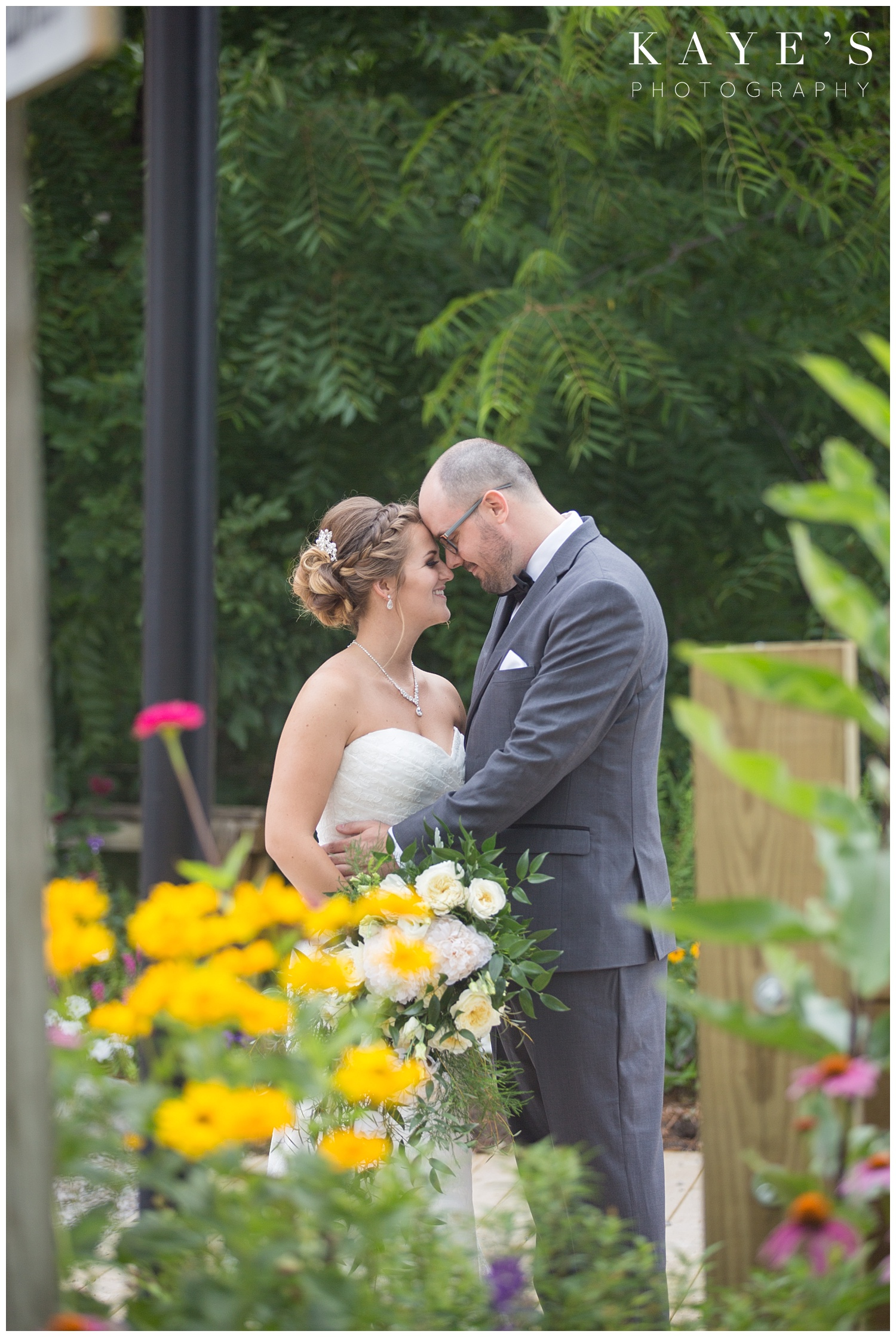 Bride and Groom during first look in flint Michigan at crossroads village