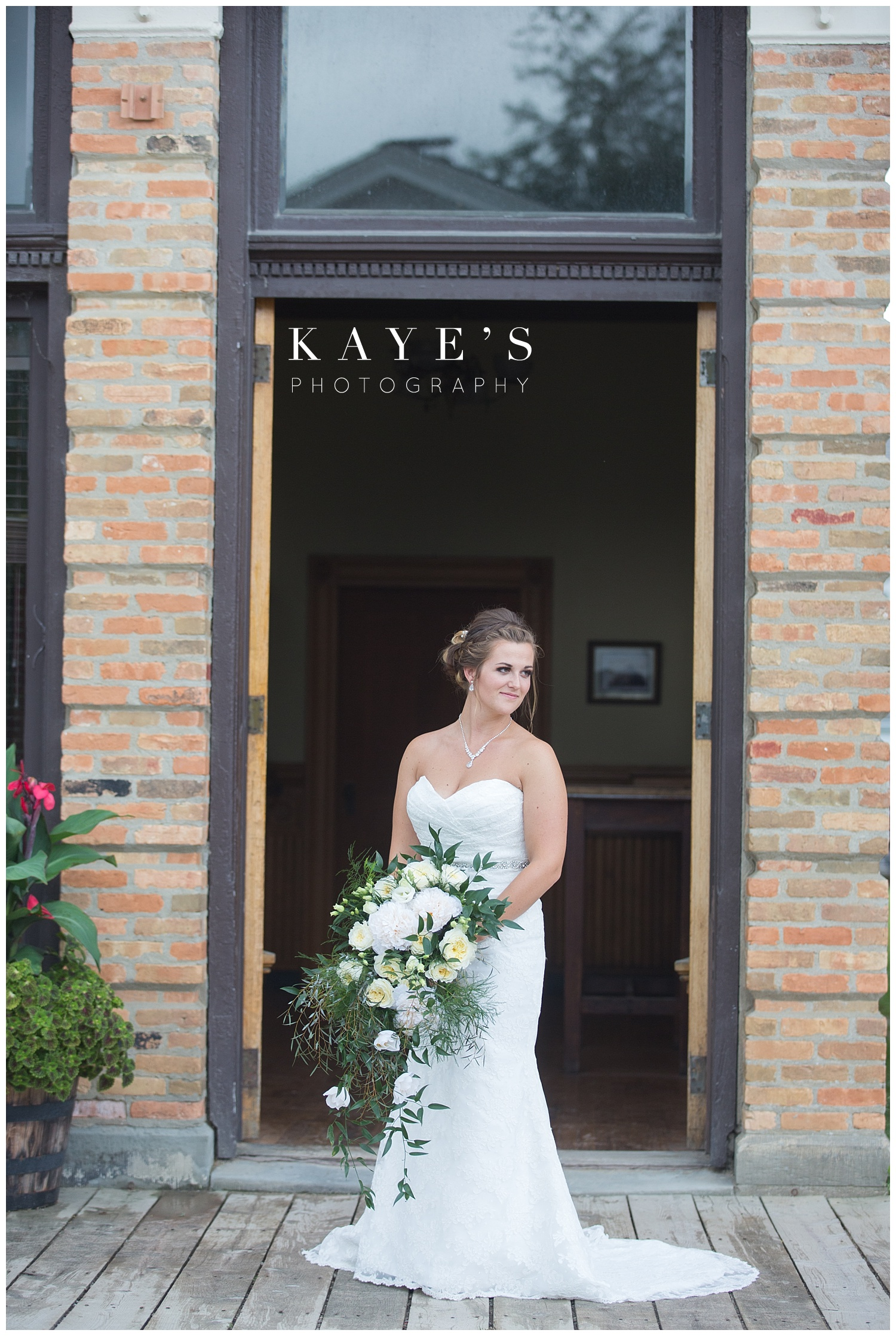 Bride posing for professional pictures in Flint Michigan at crossroads village!!
