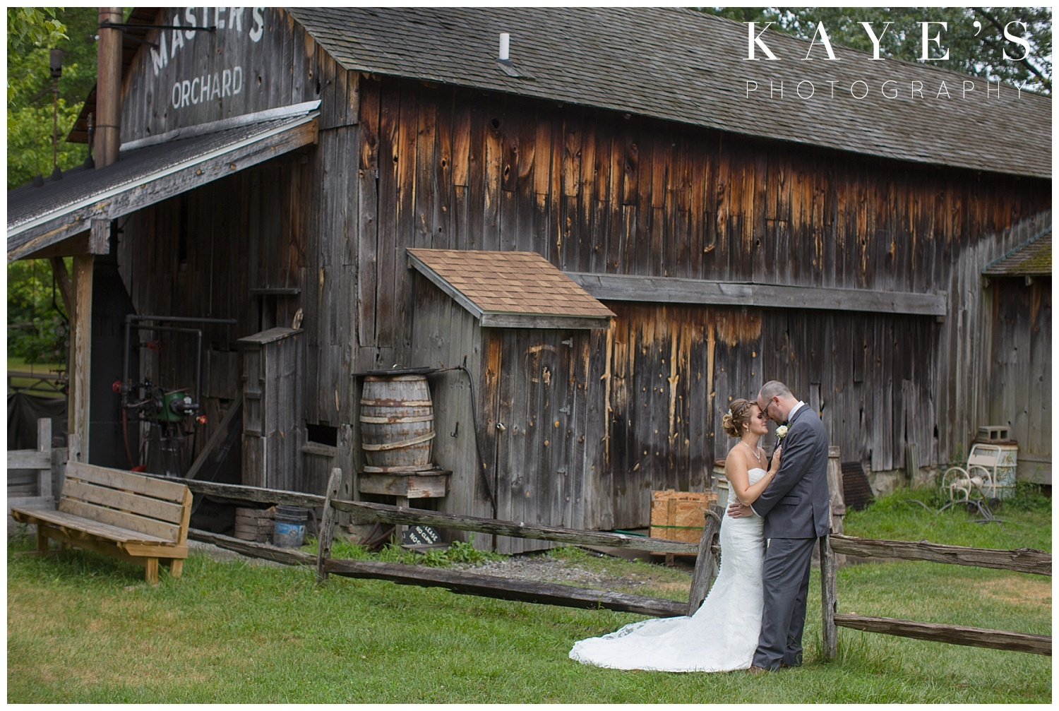 Bride and groom posing for professional photographer in flint michigan at crossroads village!!