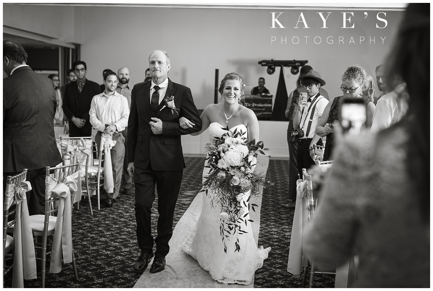 Bride walking up the isle with her father to be wed at crossroads village ceremony!!
