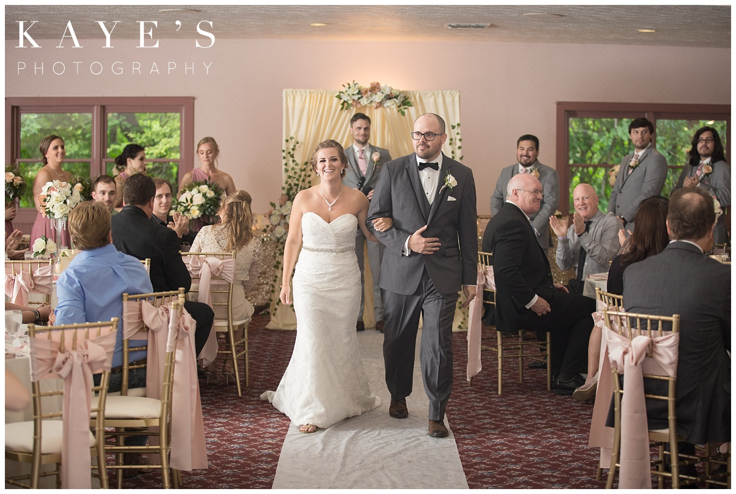 Bride and groom walking away from altar married during wedding at crossroads village!