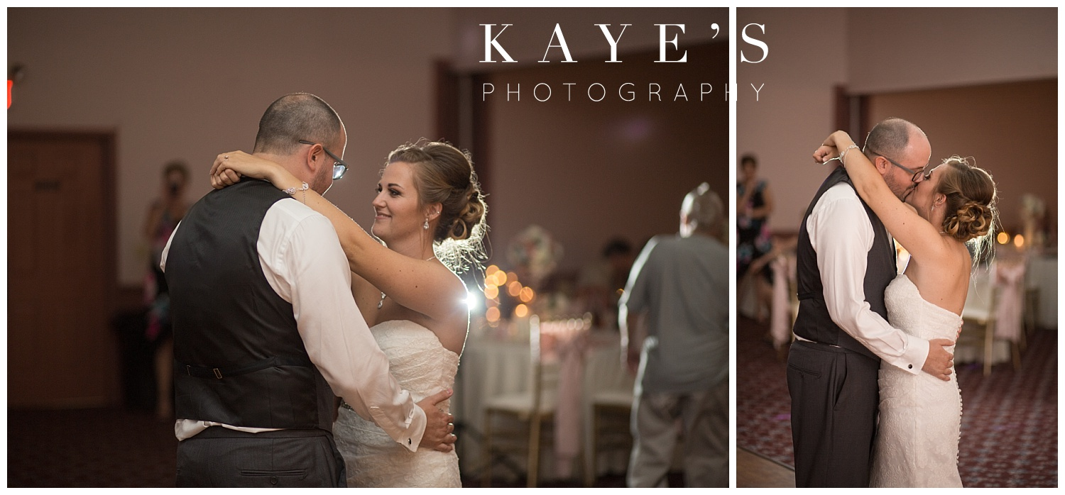 bride and groom first dance during wedding at crossroads village