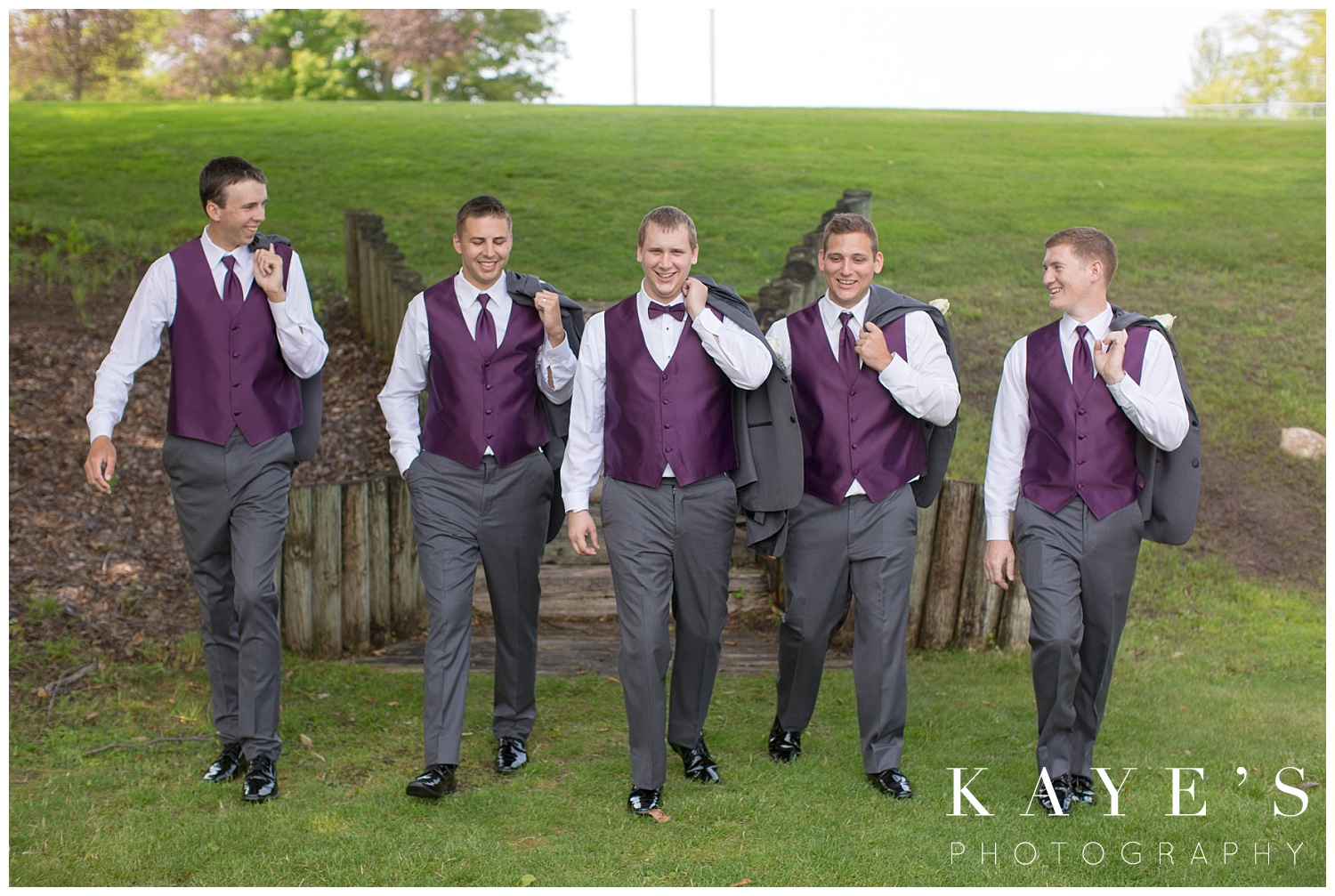 casual photo of groom and groomsmen before wedding ceremony