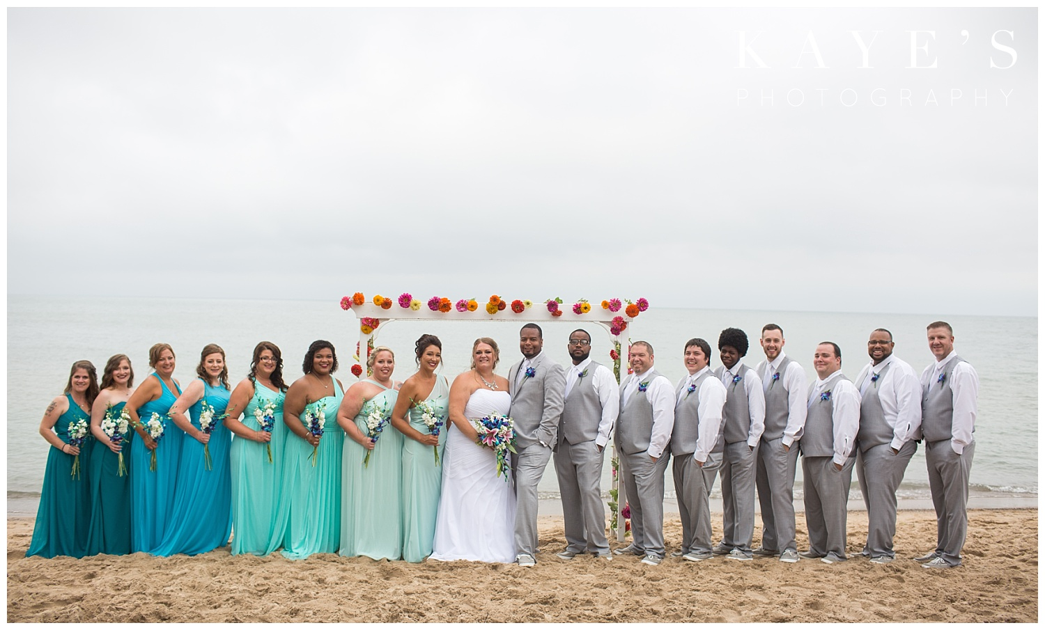 Bridal party posing for wedding photographer in tawas city Michigan
