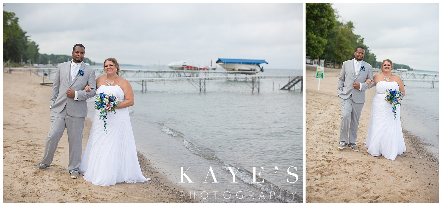 Bride and groom posing for professional wedding photographer during their tawas city Michigan beach wedding
