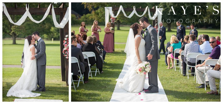 Bride and Groom kissing during wedding ceremony at Flushing Valley Golf Club