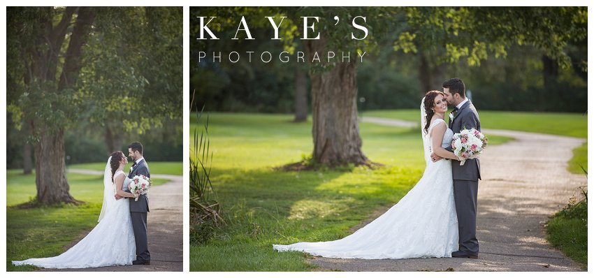 Bride and Groom posing for professional wedding photographer during wedding at Flushing Valley Golf Club
