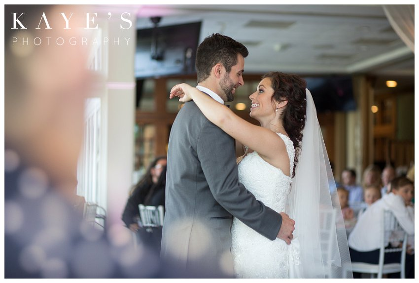 Bride and grooms first dance during wedding at Flushing Valley Golf Club
