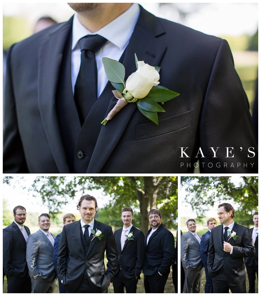 Groom getting ready and posing with groomsmen during fall wedding in Flint Mi