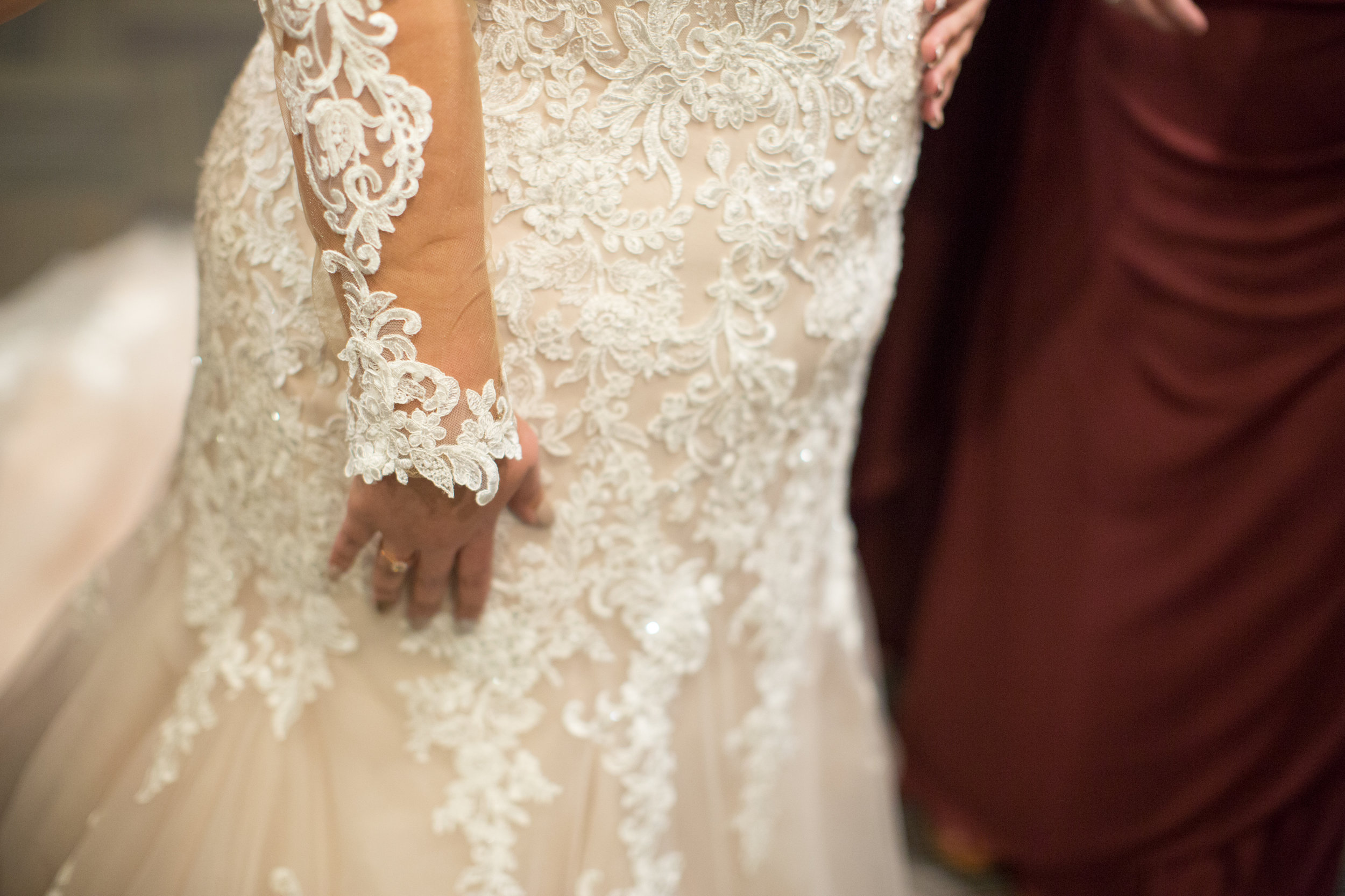 details of bride dress in a winter wedding in sterling heights michigan