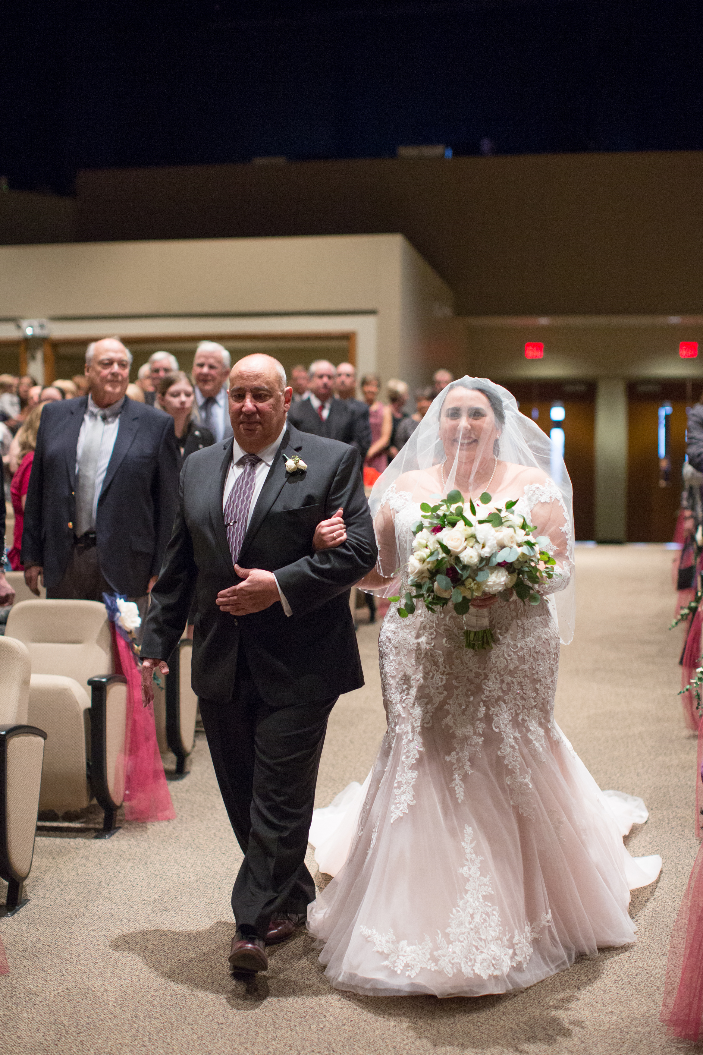 bride coming down the aisle during wedding ceremony in detroit, Michigan