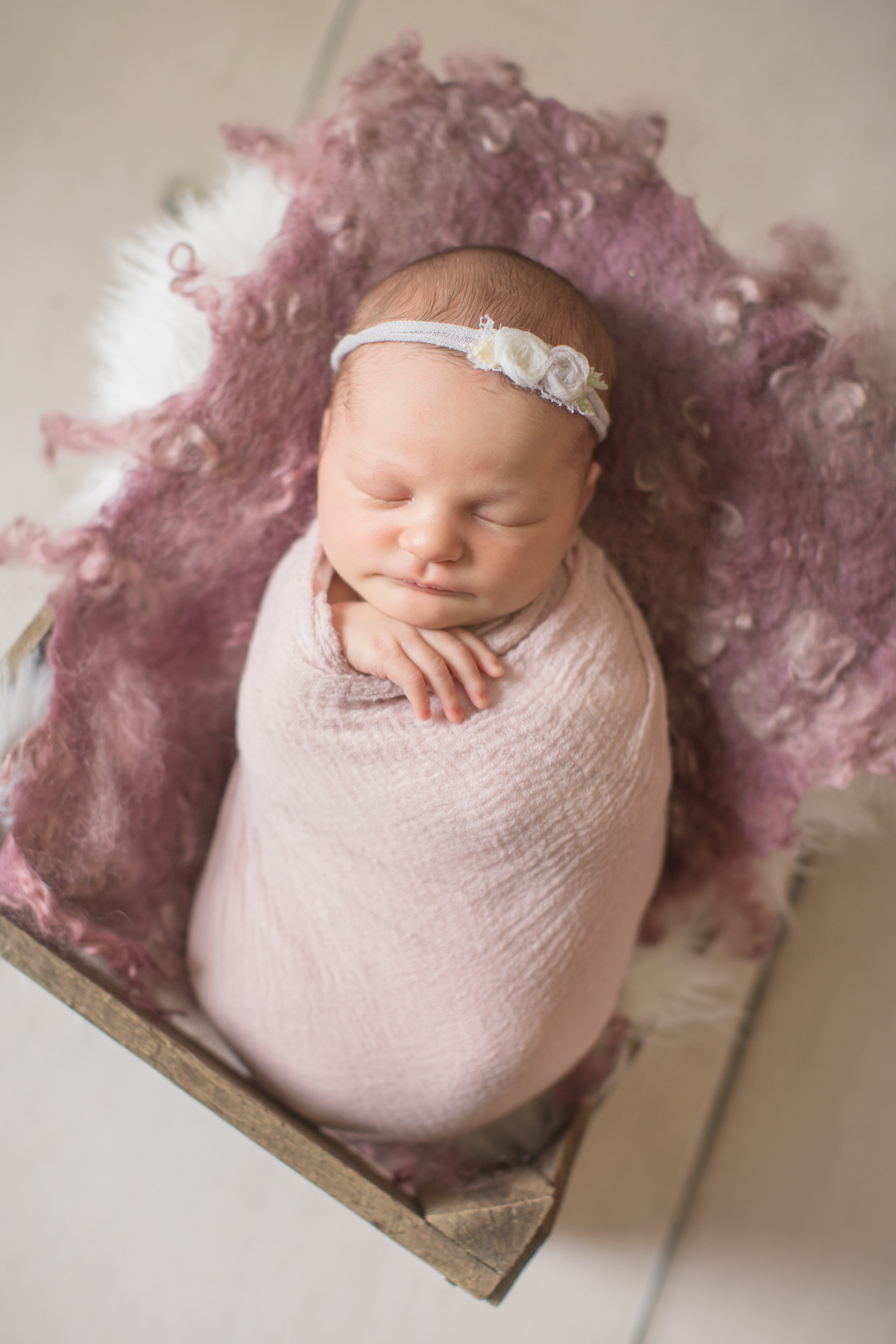 baby-girl-wrapped-during-baby-session-in-grand-blanc-michigan