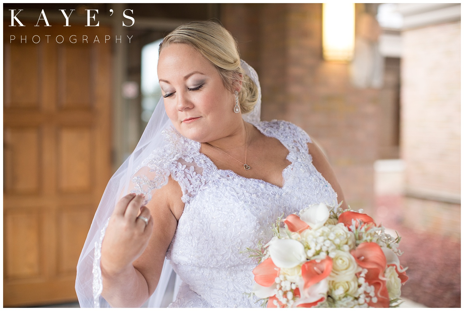wedding portraits of bride before ceremony at lapeer country club