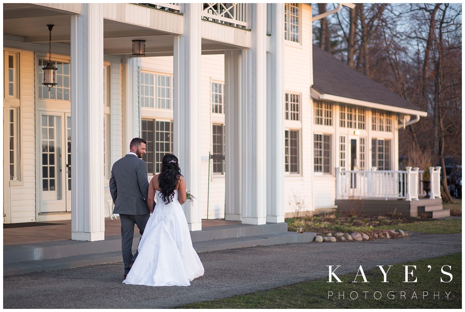 sunset wedding photos by howell michigan in front of waldenwoods
