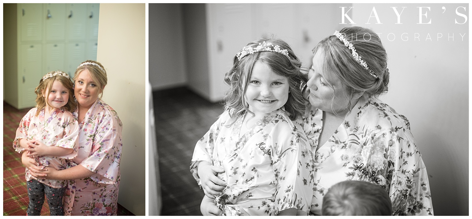 bride and flower girl before wedding getting ready in flushing michigan