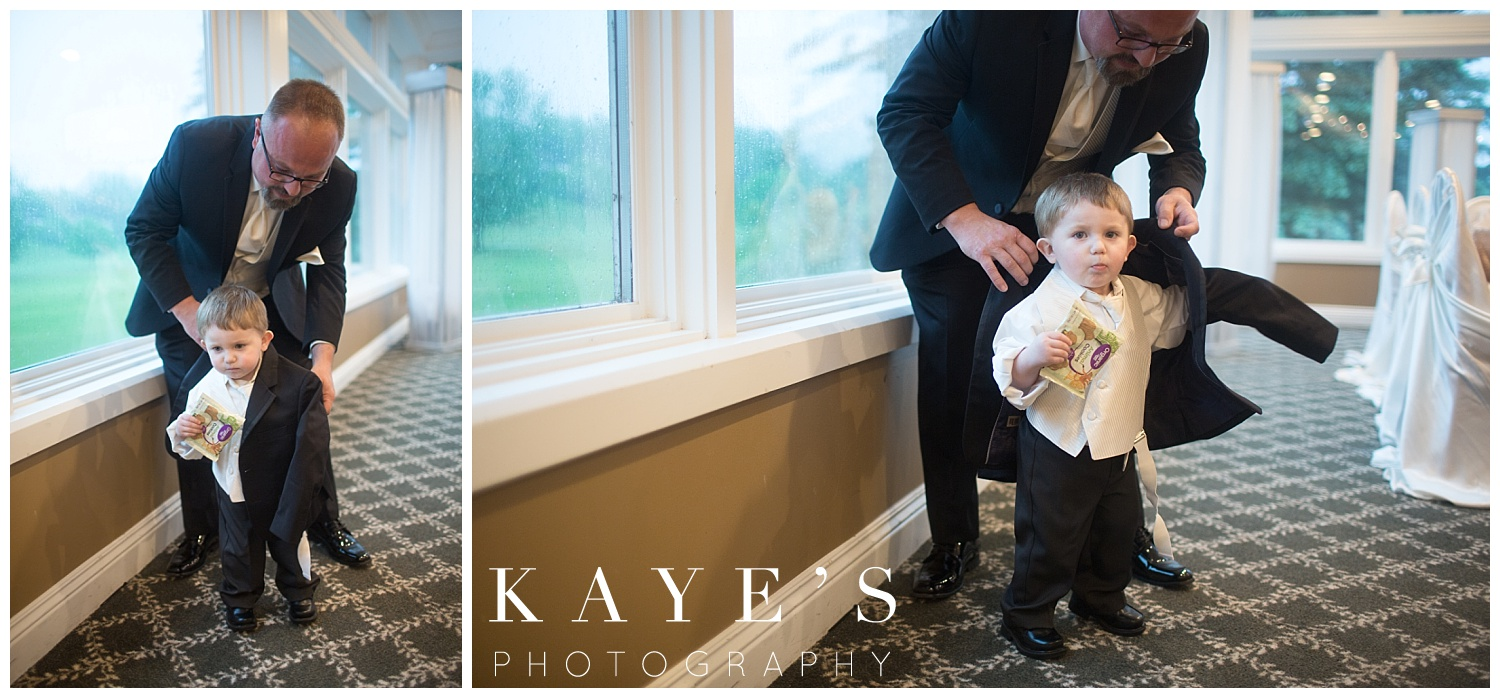 groom getting son and ring bearer ready before wedding at flushing valley golf course
