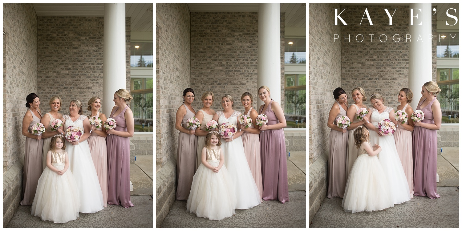 bride with bridesmaids before wedding in neutral dresses