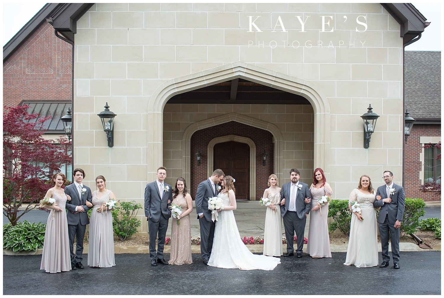 bridal party standing in front of warwick hills for wedding portraits