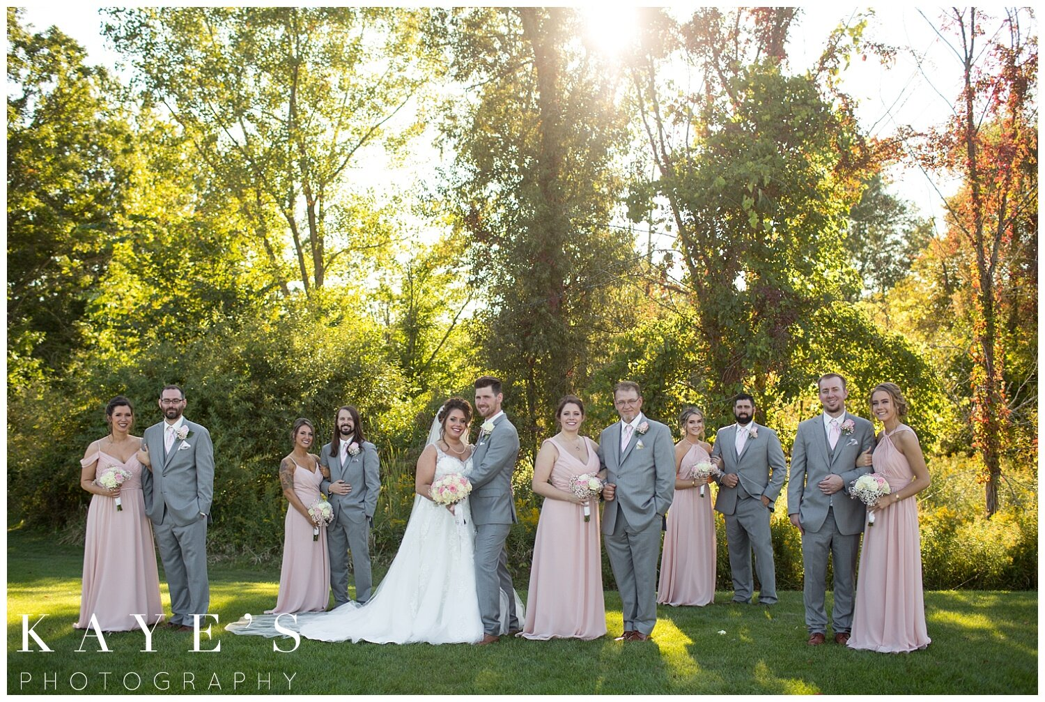 bridal party with bride and groom in grand blanc, michigan at captain's club