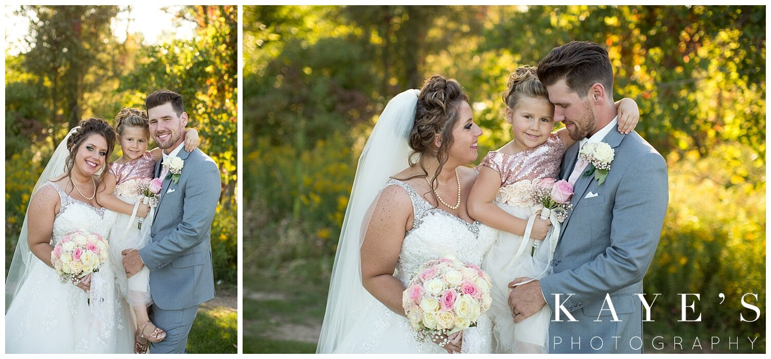 bride and groom with daughter on wedding day in grand blanc michigan