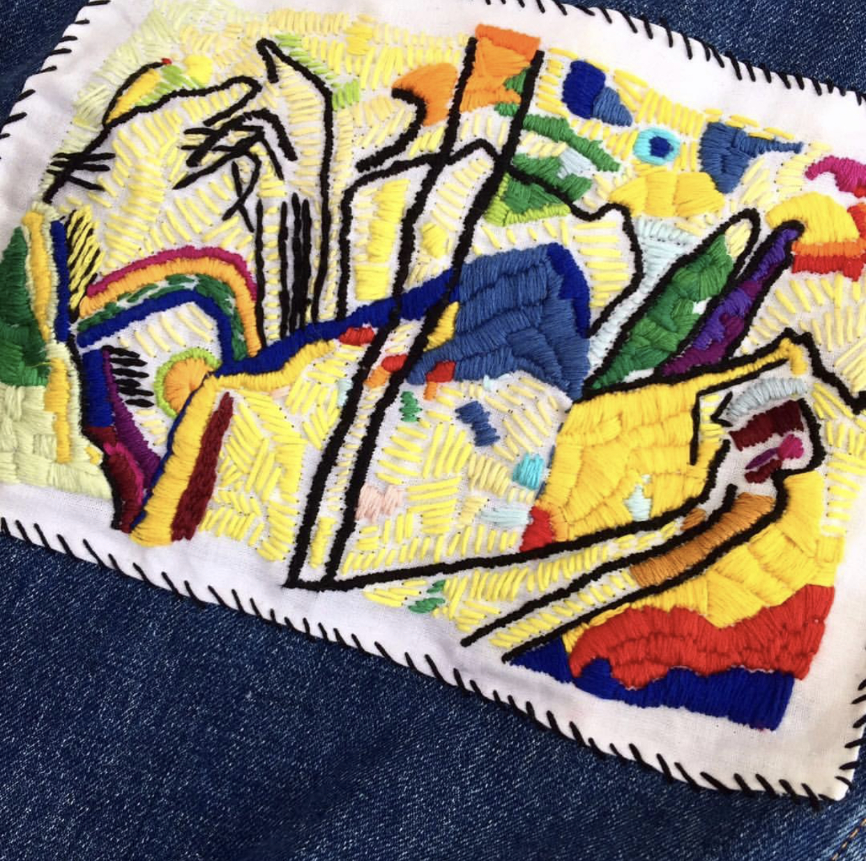 """Wassily Kandinsky's """"Composition IV"""" hand embroidered on vintage fabric then stitched on the back of a denim jacket"""