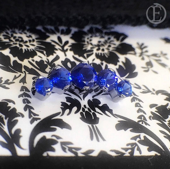 Beautiful blue 5 stone cluster perfect for a helix or conch piercing.