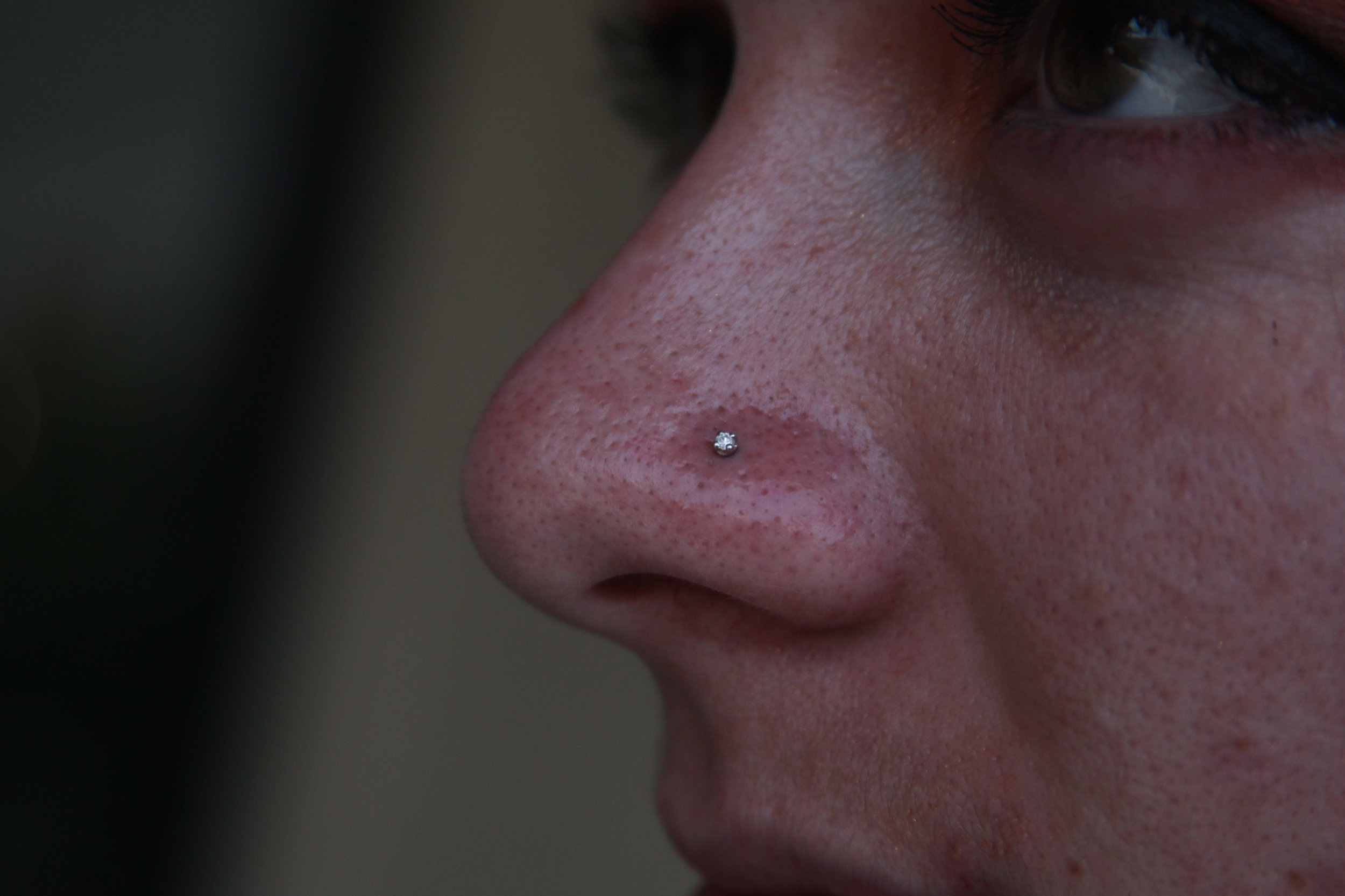 Nostril Piercings - Nostril piercings are a classic piercing that have been visible in pop culture since the 1990's. There is a wide variety of jewelry that can be worn in this piercing, depending on personal aesthetics. This piercing is started with a stud, and we recommend waiting a minimum of 4 months before attempting to switch to a ring. Full healing time can range from 6 to 9 months.