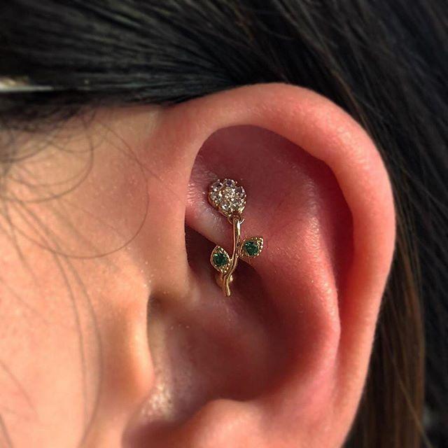 A lovely rook piercing adorned with a custom ordered daisy dangle from @bvla in solid 14k gold 😍✨ . . . . . . . . . . #losangeles #longbeach #pineave #dtlb #longbeachpiercing #bvla #goldjewelry #piercingideas #piercinginspo #cutepiercing #sanpedro #wilmington #belmontshore