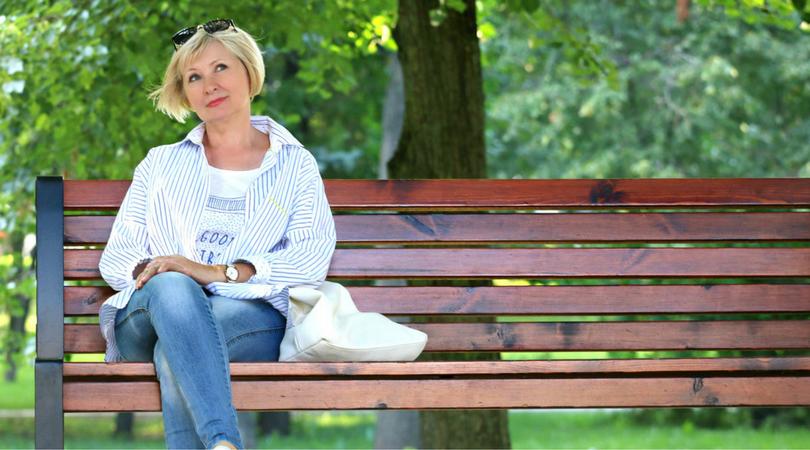 Image: Lady on bench reflecting on retirement