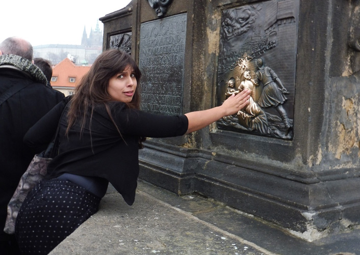 Touching the plaque of St John of Nepomuk.                                Photograph: Charlotte Roper