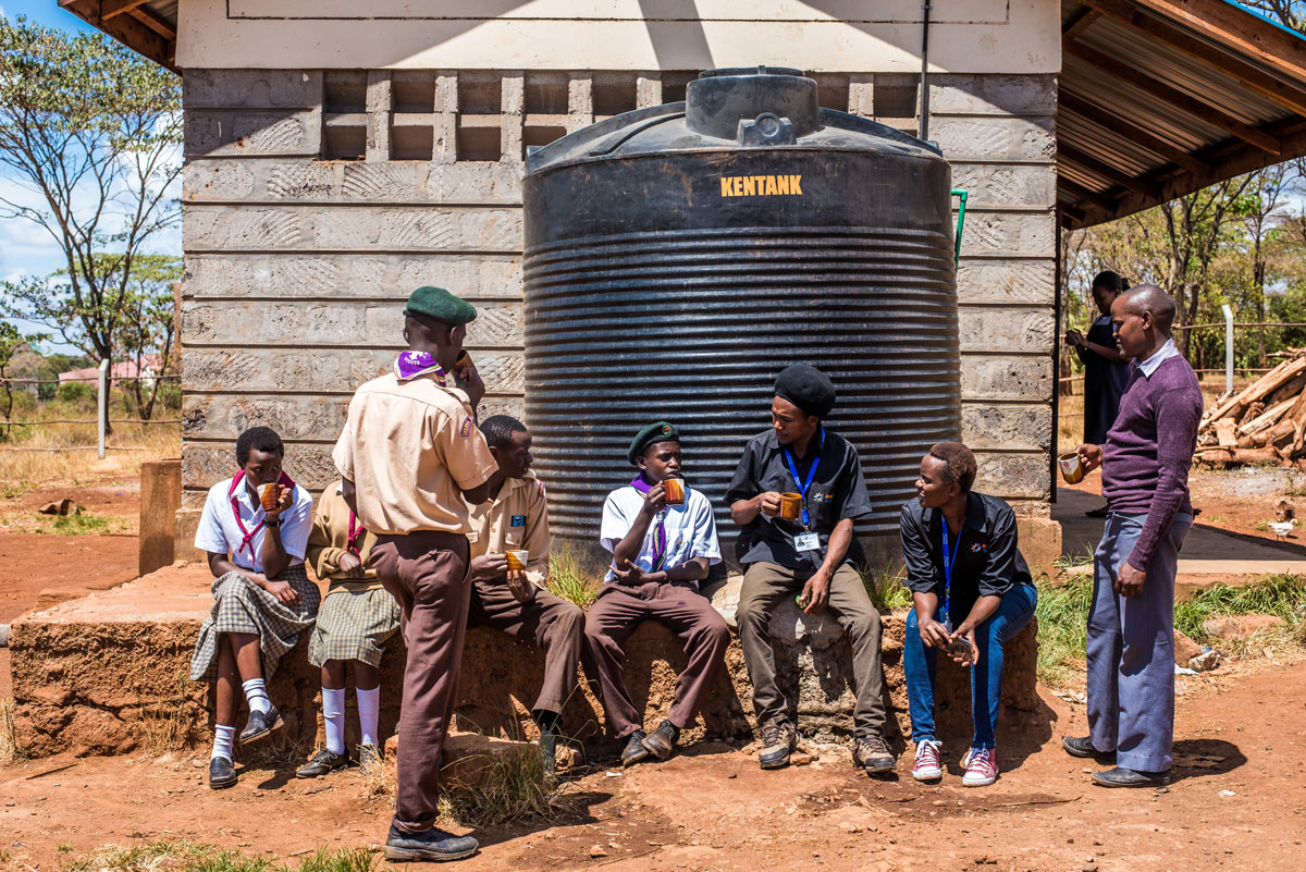 impact-water-kenya-students-outside-drinking.jpg