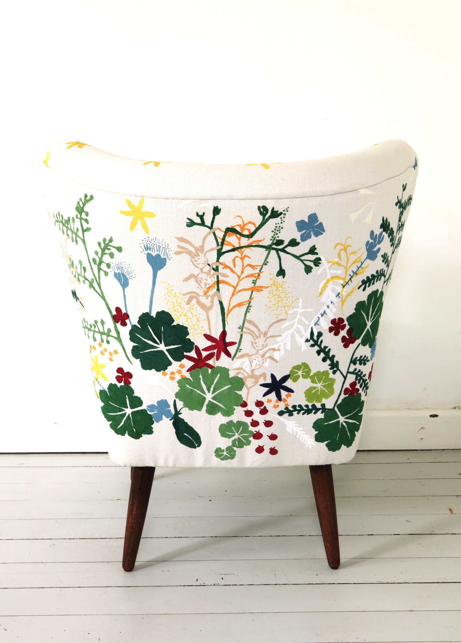 Vintage chair upholstered in hand-stencilled artist's textile Thicket Garden - Seed Bomb, designed by David Bellamy, MOMAT. Photograph Martin Hahn.