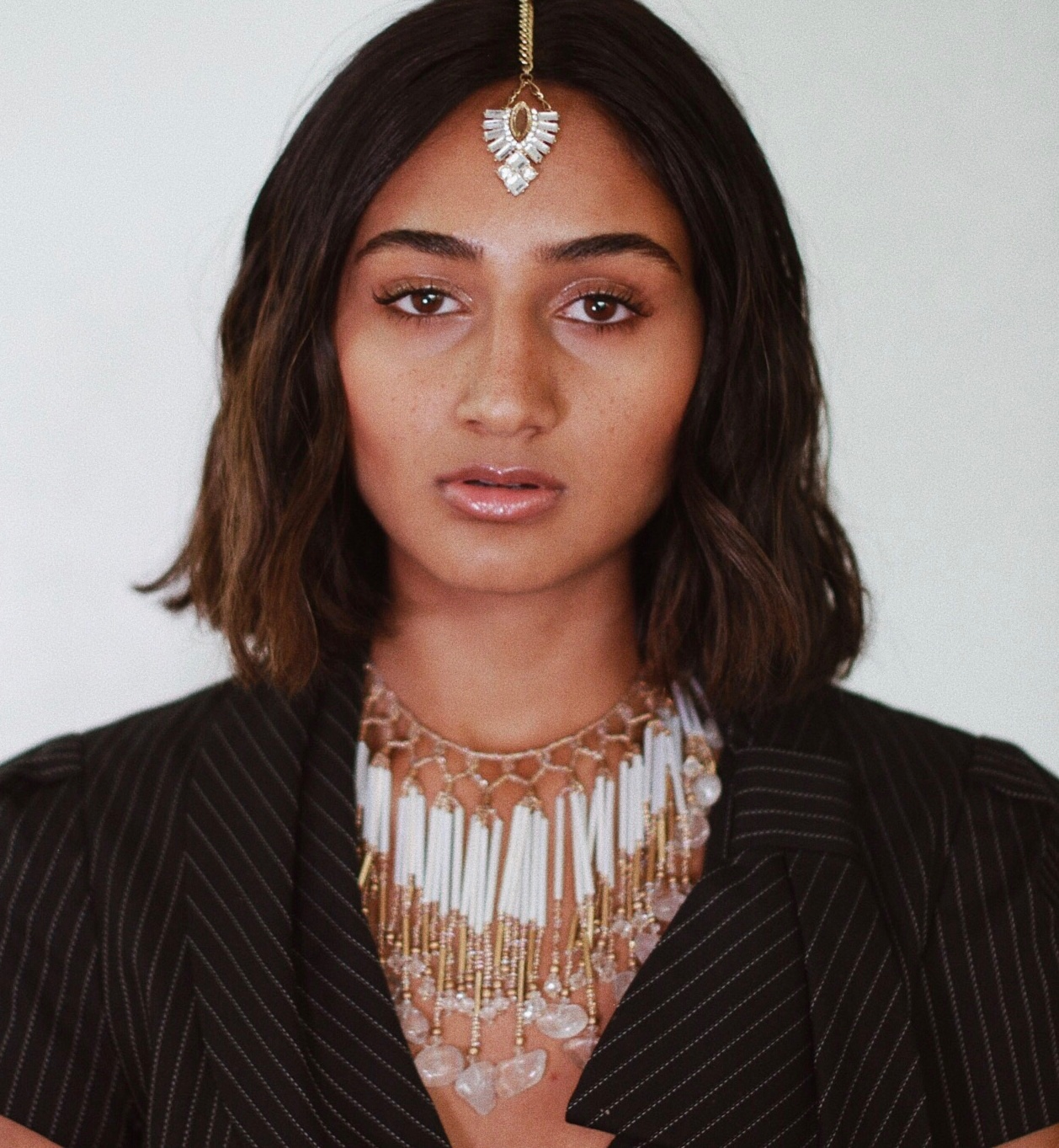 """RHEA RAJ  is a pop singer and songwriter in NYC.  She competed in American Idol's farewell season, and her audition aired on national TV in 2016. The following year, MTV featured two of her covers, """"New Rules"""" by Dua Lipa and """"I Got You"""" by Bebe Rexha, who praised Rhea's rendition on social media and a Glamour Magazine.  Rhea Raj's collaborations with producers and artists worldwide have garnered millions of streams through major record labels including Sony Music, Armada Records, and Future House Music. Recent releases have placed in LA Galaxy's """"Best Moments"""" video and been shared by The Chainsmokers, Tiesto, and Nicky Romero. Music videos for """"Feel Again,"""" """"Far Away,"""" """"Tidal Waves,"""" and """"Rewind"""" debuted in 2017.  Rhea starred in her first short film,  Hasim October , which premiered at NYU's Cantor Film Center in 2017. She has performed at prestigious venues including the Dolby Theatre in LA, Skirball Center for a United Nations event, House of Blues, and TV channels including FOX, CBS, and ABC.  In 2018, Rhea Raj released her single """"Insecurities."""" She fuses electronic and world sounds into her music, and cites Rihanna, Shakira, and M.I.A as influences. Rhea Raj has a notable international fanbase and looks forward to sharing her new projects."""