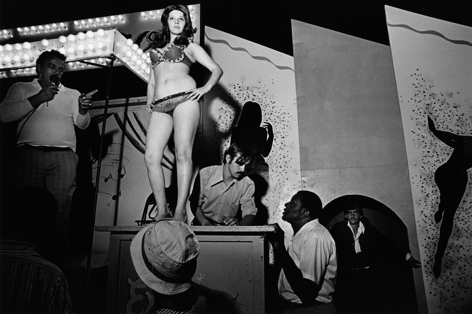 Lena on the Bally Box, Essex Junction, Vermont, 1973.  From Carnival Strippers © Susan Meiselas/Magnum Photos