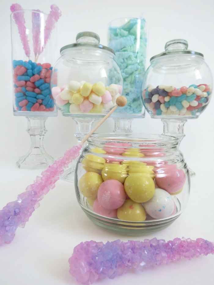 Looking to add some fun to your next party? Check out this easy tutorial to create your own candy bar with items from the dollar store! #candybar #candybuffet #candytableideas
