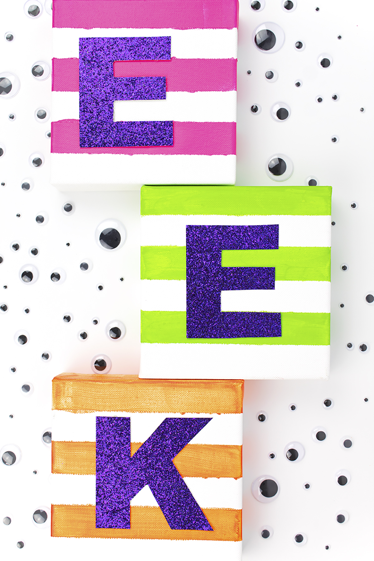While I love the traditional black and orange, I wanted something with a little more color to add a pop to my usual Halloween decor. Click to check out the easy DIY! #halloweenart #diyhalloween #halloweencrafts