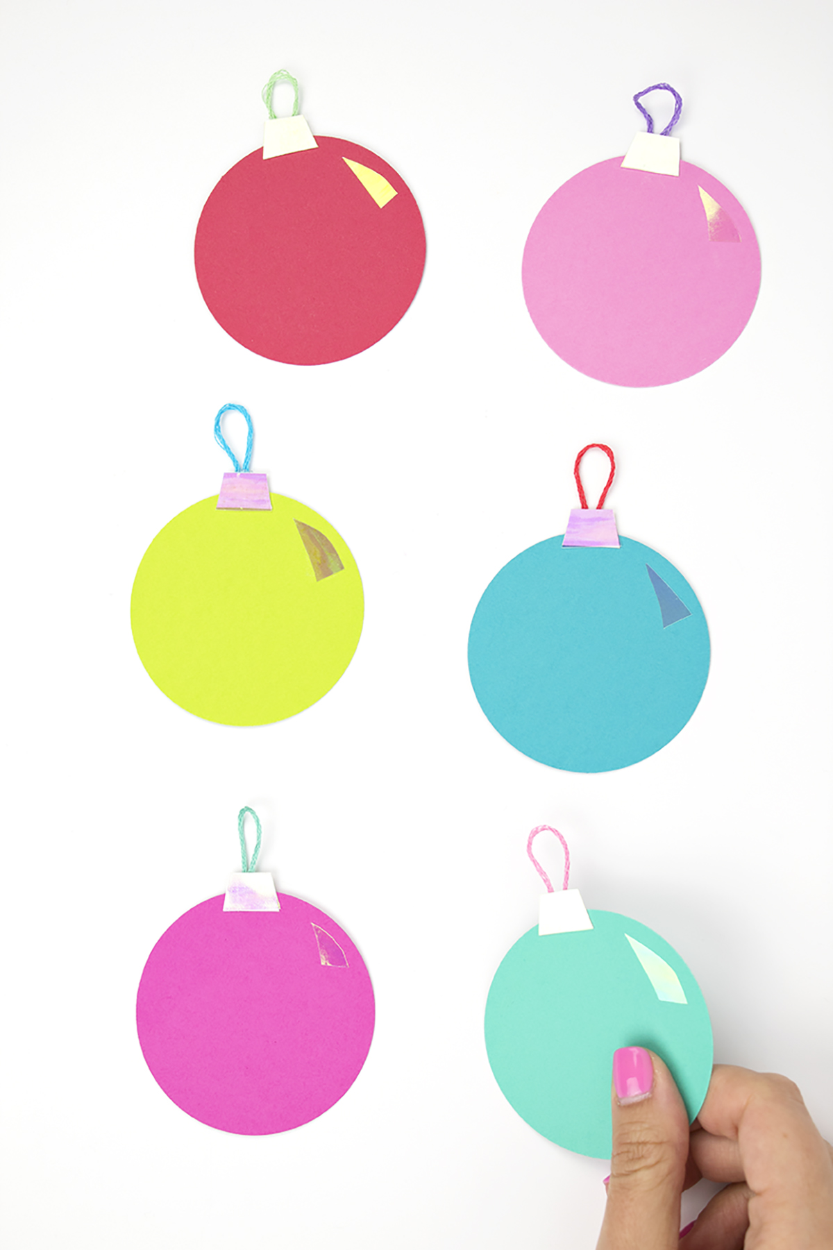 The iridescent effect on these ornaments is super 90's, while also being modern. Holographic items are coming back! Give them to all your friends who love the 90's as much as you do! Click for the DIY. #diychristmasornaments #diygifttags#diychristmascrafts