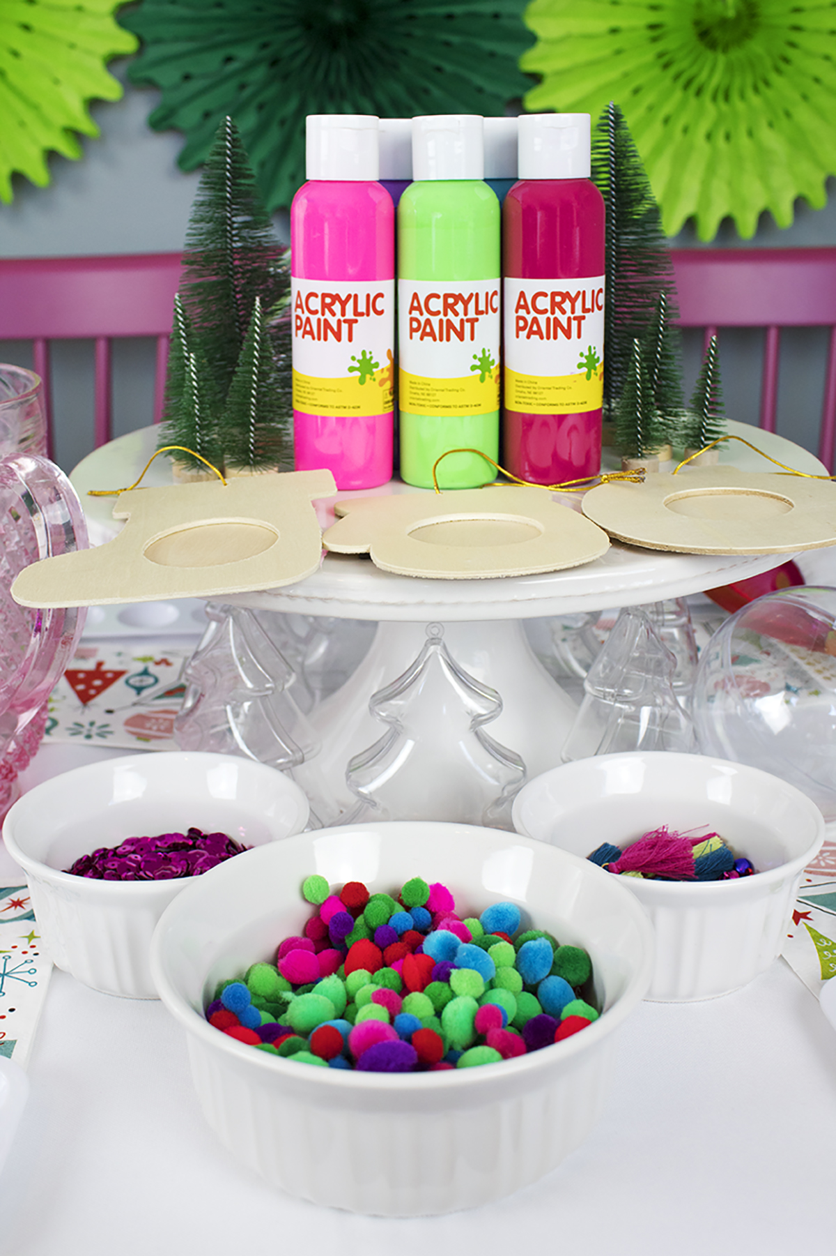 I wanted to whip up a simple party that brings my friends together to do something I personally LOVE- making ornaments! While everyone else is baking cookies, you can find us creating one-of-a-kind baubles for our tree that we can use year after year. Click to see the full party! #christmaspartyideas #christmascrafts #diychristmasornaments #cookieexchangeparty