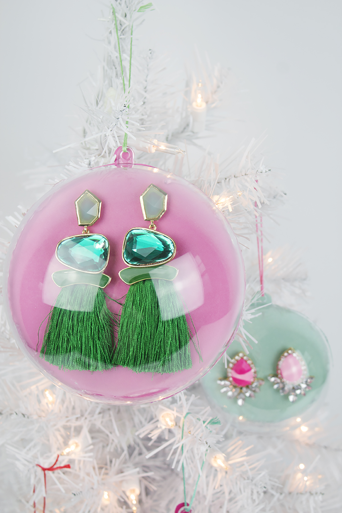 Looking for a great stocking stuffer or Secret Santa gift? These earring ornaments are way more fun than regular ho-hum packaging, and they're super easy and affordable to do! Click to find the full DIY and check one more thing off your to do list. #diyornaments #stockingstuffer #secretsantagift