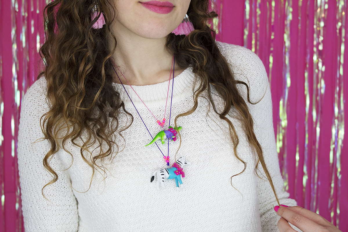 These animals in sweaters are so cute that everyone wants them! They would make a great gift for a winter or animal/dinosaur-themed party, or even as party favors! Click for the DIY. #diyjewelry #handmadejewelry #diygifts