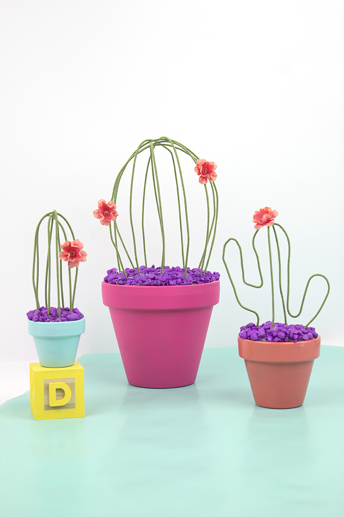 Do you somehow kill all your plants like I do? In an effort to save the plants, I've decided I'd better stick to fake plants from now on. So, I decided to make these little beauties! This wire cactus is perfect for your home. Click for the full how-to!