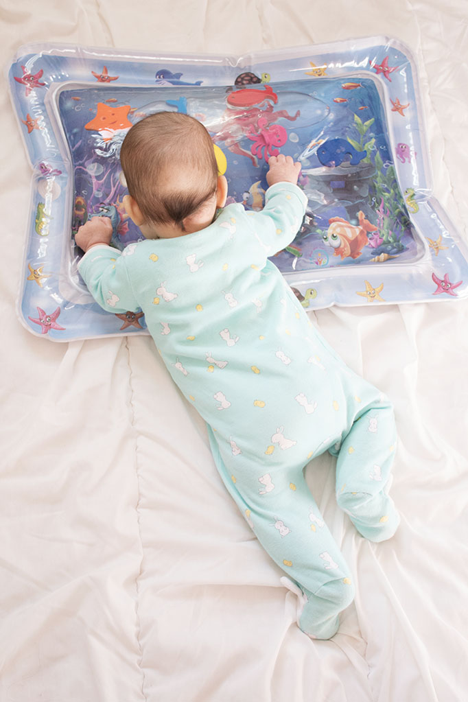 Make tummy time more fun for baby with this water toy! It's a great baby shower gift idea and perfect for playing with baby. Click to learn more about this baby list must-have item! #tummytime #tummytimeproducts #bestbabyproducts
