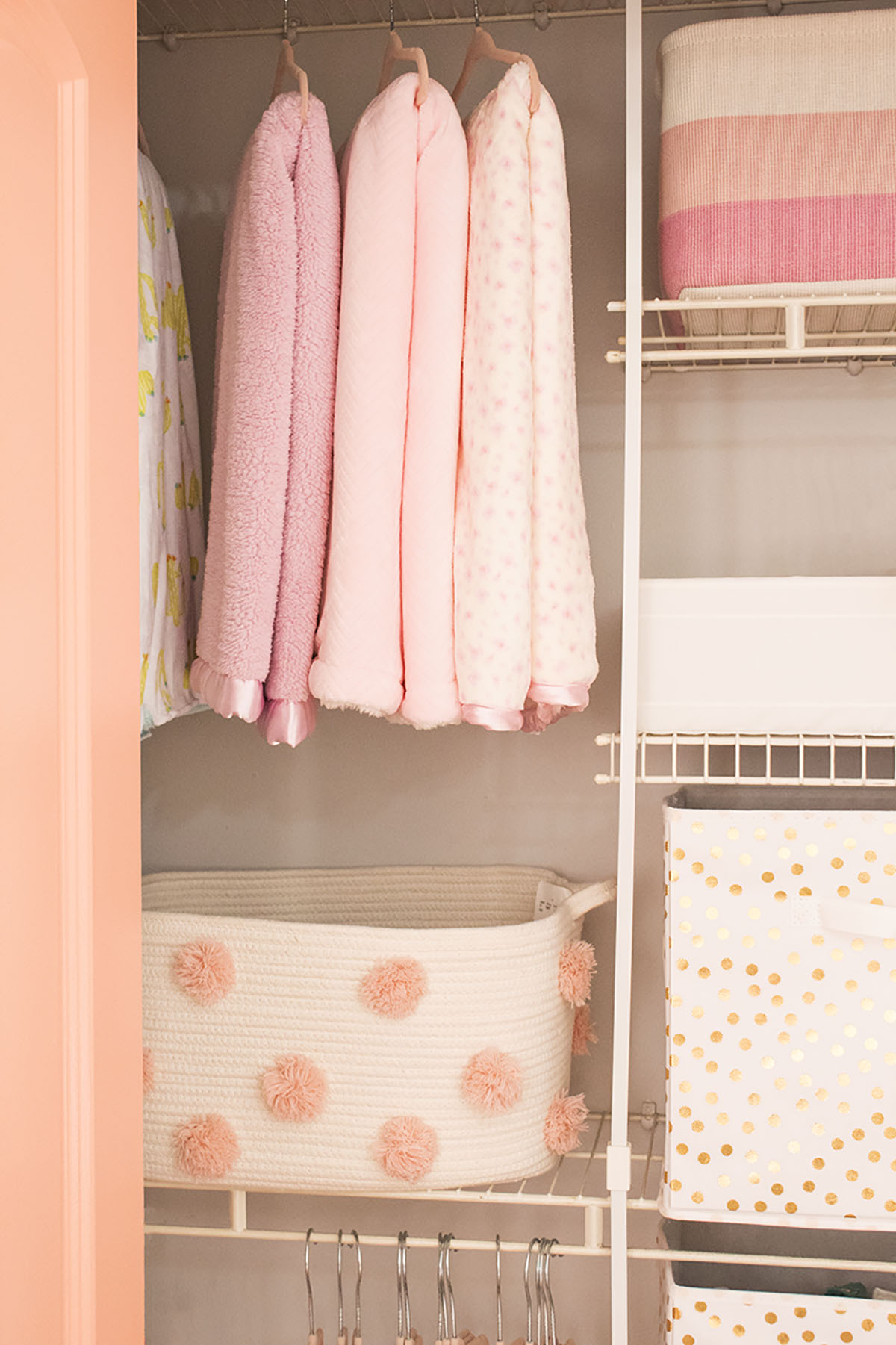 Looking for some nursery organization ideas? Check out this colorful and affordable nursery tour! From the closet to the dressers, I'll show you where to store all of baby's essentials. #nurseyorganizationideas #nurseryorganizationhacks #nurseryorganizationcloset