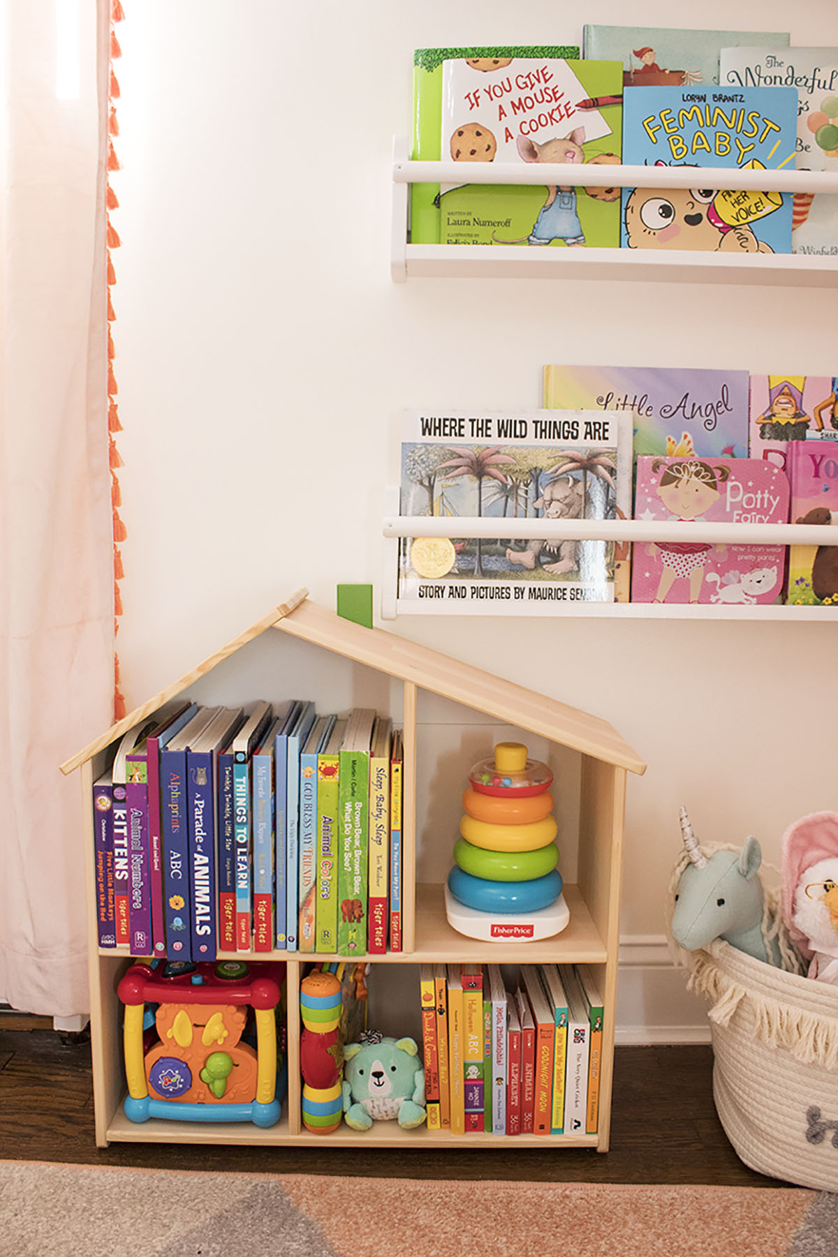 Looking for some nursery organization ideas? Check out this colorful and affordable nursery tour! From the closet to the dressers, I'll show you where to store all of baby's essentials. #nurseyorganizationideas #nurseryorganizationhacks #nurserybookshelf