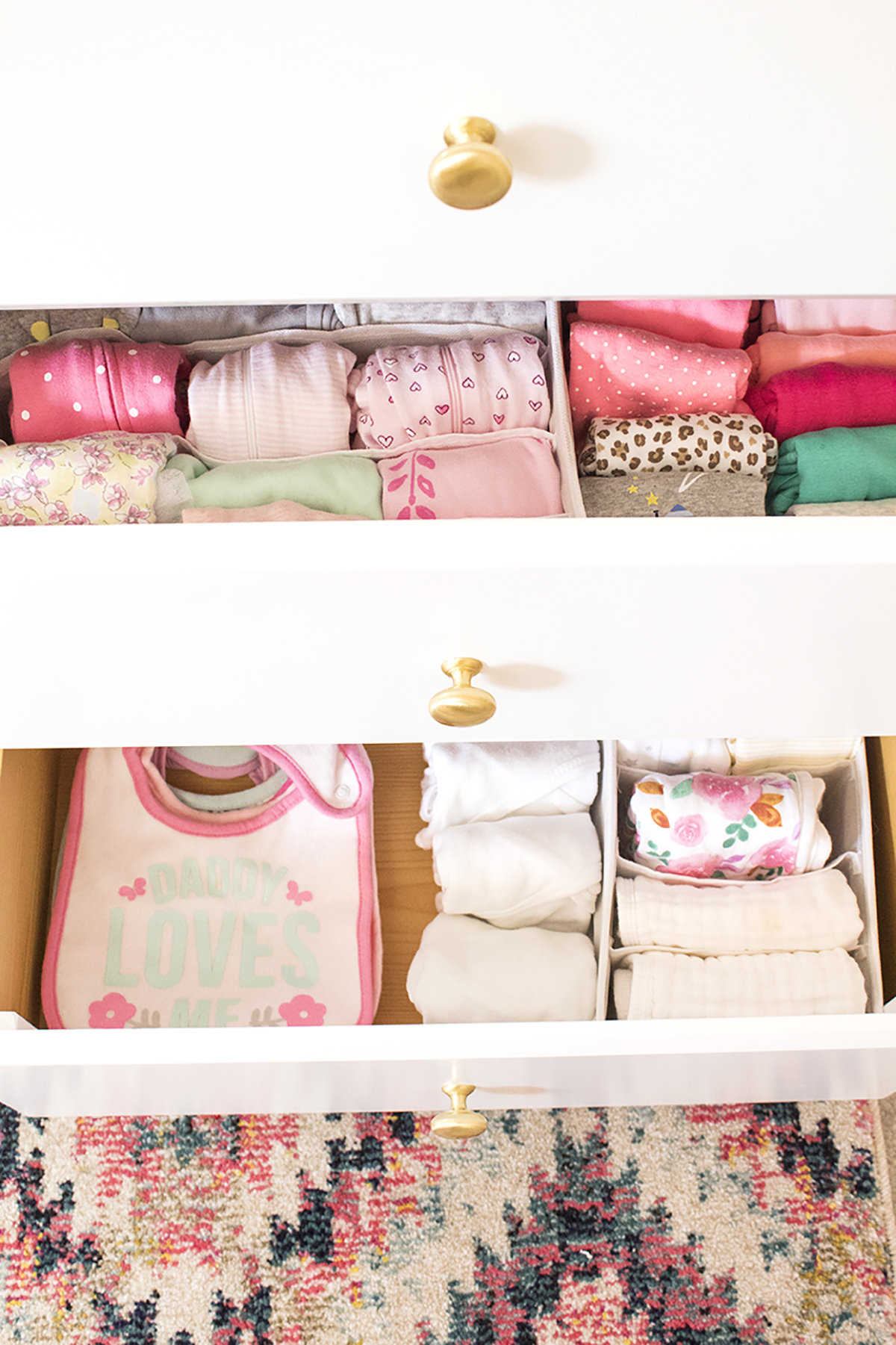 Looking for some nursery organization ideas? Check out this colorful and affordable nursery tour! From the closet to the dressers, I'll show you where to store all of baby's essentials. #nurseyorganizationideas #nurseryorganizationhacks #nurserydresserorganization