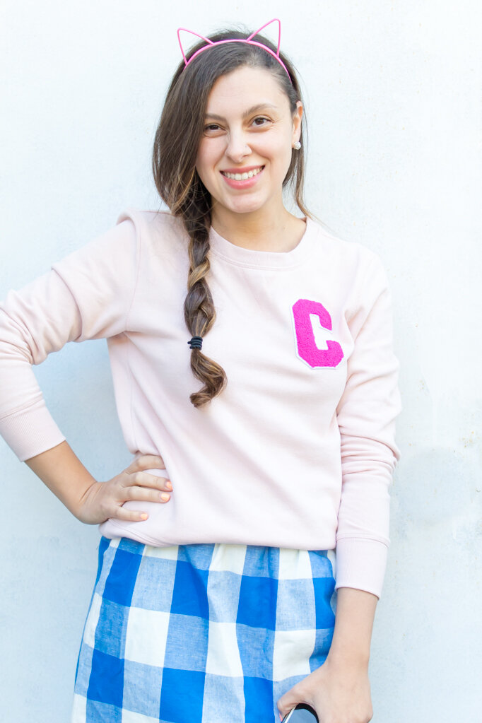 Maybe it's because of all the back-to-school stuff or the fact that it's fall, but suddenly I want nothing more than a cozy sweater with a cute fluffy letter on it. This varsity sweater is really easy to make- so easy, it almost isn't a DIY! Click for the directions plus links so you can make your own! #varsitysweatshirt #varsitysweateroutfit #diyvarsitysweater