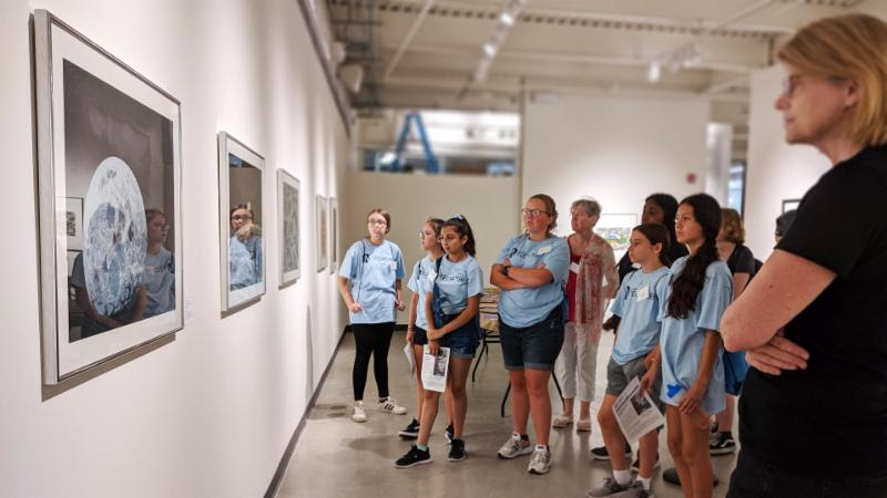 Director of Education , Saskia Schmidt, leads a guided tour in the Stockton University Art Gallery.