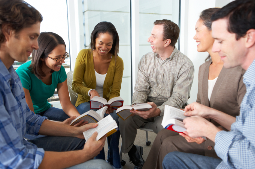Bible-group-reading-together-in-a-close-circle-000024896791_Small.jpg